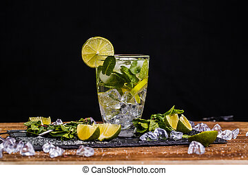Mojito on brown wooden table - Glass with mojito on brown...
