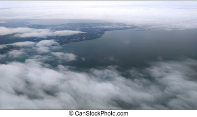 Above Puffy Clouds - The plane flies over Netherlands on...