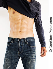 Muscular male model showing his abs,Healthy lifestyle...