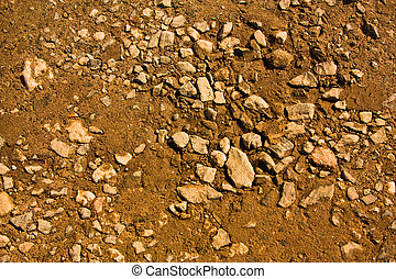 Gravel, clay and sand in the background