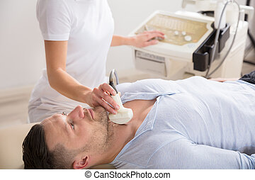 Young Man Getting Ultrasound Of A Thyroid