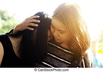Friends hugging and giving consolation