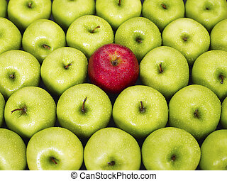 red and green apples - red apple standing out from large...