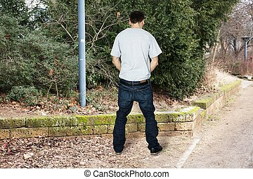 Man Peeing Outside - Rear View Of A Man Peeing Outside