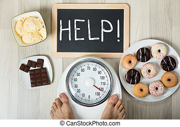 Man Measuring His Weight With Help Sign And Dessert - A...