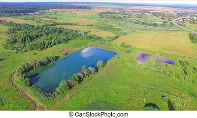 Aerial view of artificial fishing pond among the fields