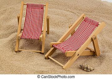 deckchair on sandy beach - a small deck chair (model) on a...