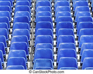 tribune with blue chairs, symbol photo for background,...