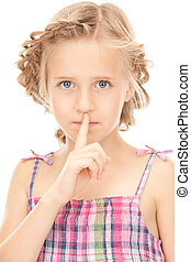 finger on lips - bright picture of pretty girl with finger...