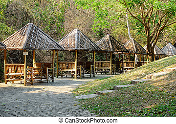 Bamboo Booths Resort - Several small bamboo booths at a...