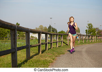 Running woman Outdoor Workout in a Park