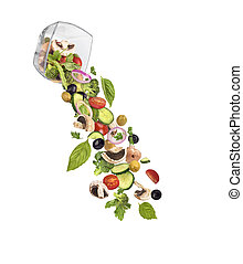 Falling salad in a glassware on a white background