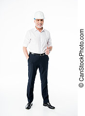 Mature male architect in hard hat smaling and showing thumb...