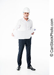 Mature male architect in hard hat standing with blueprint