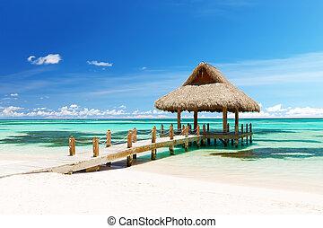 Beautiful gazebo on the tropical white sandy beach in Punta...