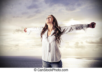 Woman feeling free - Brunette woman feeling free outside