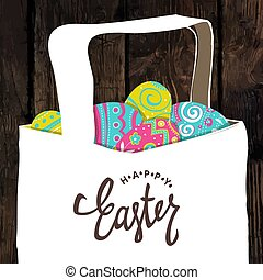 Basket with Easter colorful eggs. Happy Easter calligraphy. Wooden board background. Easter postcard.