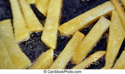 French fries cooking in boiling oil. UltraHD 4K video