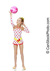 Gymnast does exercises with a ball - Beautiful little girl...