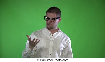 A textured man with bristles and glasses controls his hands with a hologram on a green background