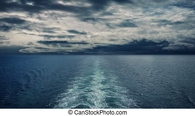Sailing On The Ocean With Dramatic Sky - POV from back of...