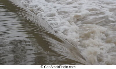 Weir water. - Smooth water flows into rough churning water....