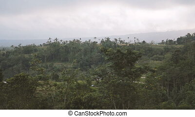 Panorama view on agricultural fields near Batur volcano...