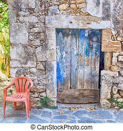 Old painted blue door on the ancient stone wall, Greece -...