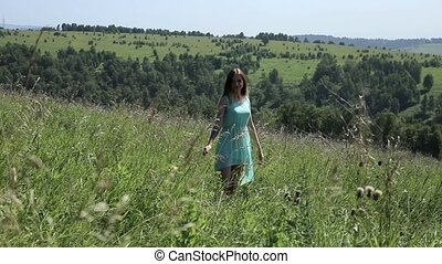 young girl spinning on a green grass, girlfrend in nature