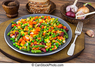 Mix of roasted vegetables in pan. Studio Photo