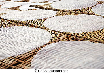 Rice paper drying at a bamboo frame