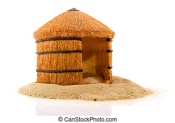 African straw hut in the sand isolated over white