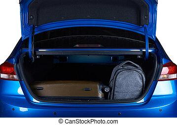 Bags in open modern car trunk. Full loaded blue car trunk...