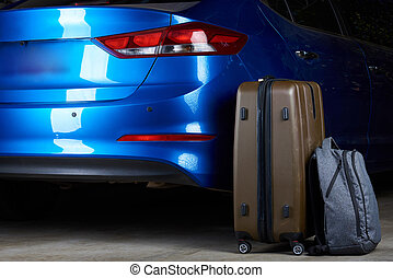 Luggage stand next to closed car trunk - Luggage stand next...