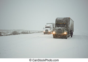 Truckers putting on chains in a fierce winter storm