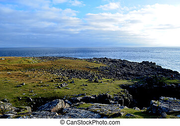 Black Rocks Covering the Coastline at Neist Point - Black...