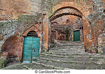 Pitigliano, Tuscany, Italy: old stairway, cellar doors and...
