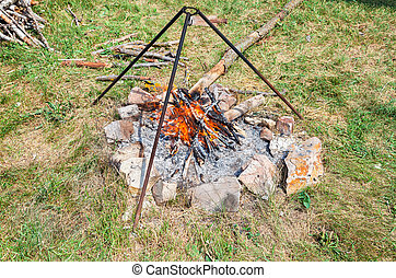 Campfire for cooking food at the outdoors in summer sunny...