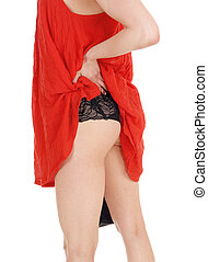 Woman showing her bottom. - A young slim woman standing in a...