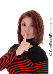 Young woman with finger over mouths. - A pretty woman in a...
