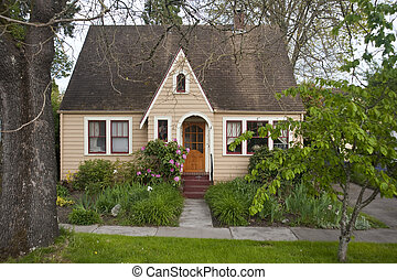 Old-fashioned bungalow - Older clapboard bungalow surrounded...