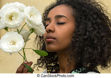 African beauty and roses - African Ethiopian young woman...
