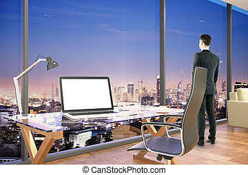 Businessman in office - Side view of young businessman...