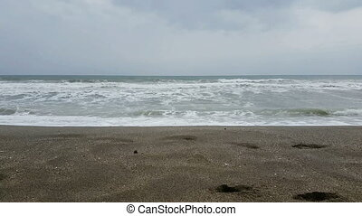 Sea waves on the beach, mediterranean coast