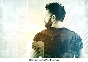 Young businessman on city background - Back view of young...