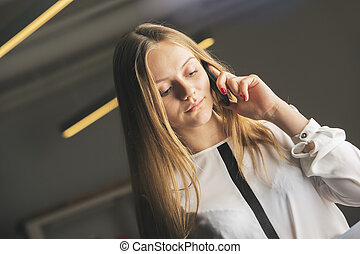 Girl talking on the phone - Portrait of attractive caucasian...