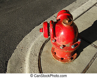 Round fire hydrant - Old style round red fire hydrant on the...