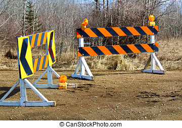 A construction and detour sign blockage.