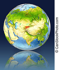 Kyrgyzstan on globe with reflection. Illustration with...