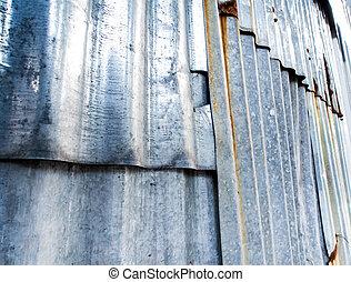 Rusty corrugated galvanized sheet iron fence